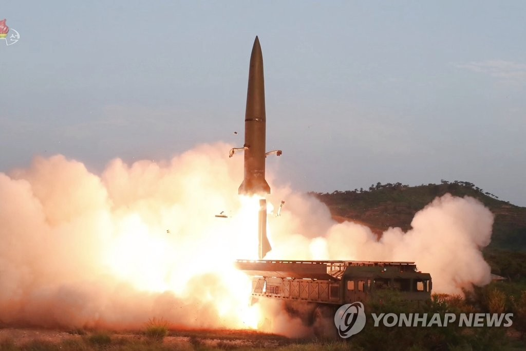 This imaged from footage aired by North Korea's Korean Central Television on July 26, 2019, shows a short-range missile being fired from a transporter erector launcher on the Hodo Peninsula near the North's eastern coastal town of Wonsan the previous day. (For Use Only in the Republic of Korea. No Redistribution) (Yonhap)