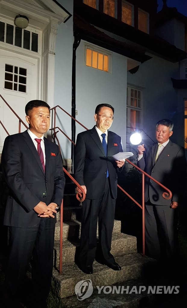 Kim Myong-gil (C), North Korea's top nuclear negotiator, reads a statement in front of the country's embassy in Stockholm on Oct. 5, 2019, after a meeting with U.S. officials. He said the talks broke down due to the failure of the United States to come up with a new proposal. (Joint Press Corps-Yonhap)