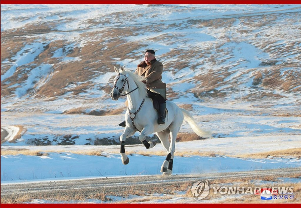 This photo, released by the Korean Central News Agency on Oct. 16, 2019, shows North Korean leader Kim Jong-un riding a white horse up a snow-covered Mount Paektu, the country's highest peak on the border with China, after inspecting construction sites at the foot of the mountain. (For Use Only in the Republic of Korea. No Redistribution) (Yonhap)