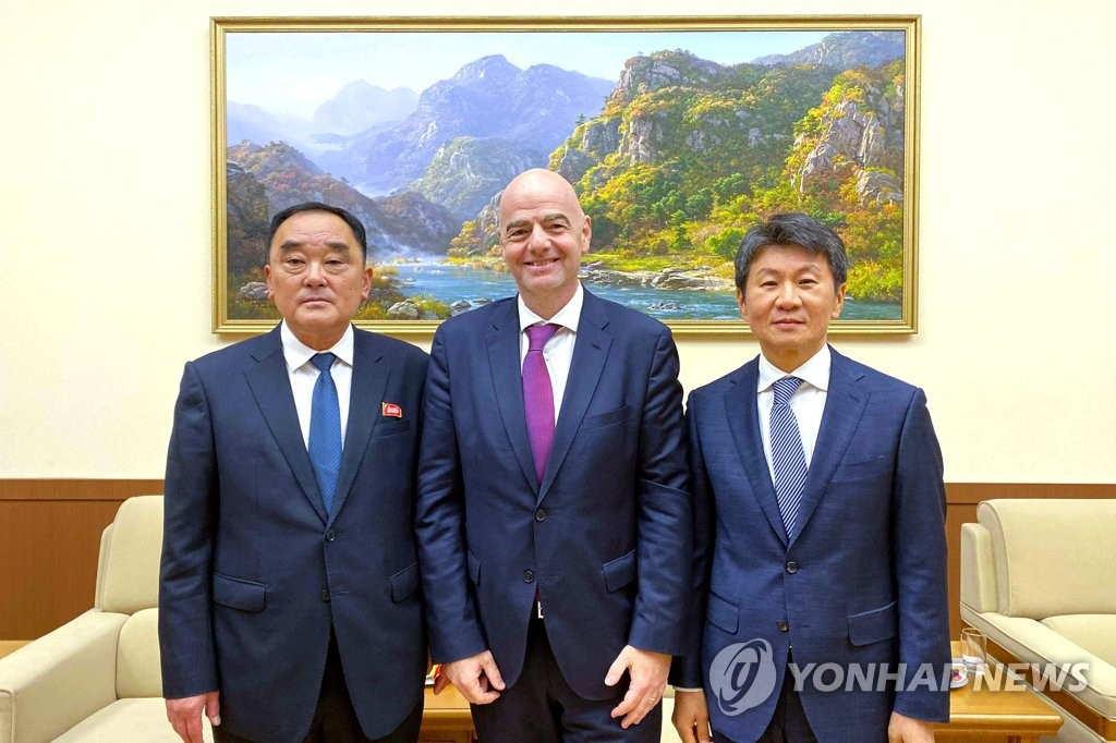 In this file photo provided by the Korea Football Association (KFA) on Oct. 16, 2019, FIFA President Gianni Infantino (C) is flanked by Kim Jang-san (L), secretary general of the North Korean football association, and Chung Mong-gyu, head of the KFA, during their meeting in Pyongyang. (PHOTO NOT FOR SALE) (Yonhap)