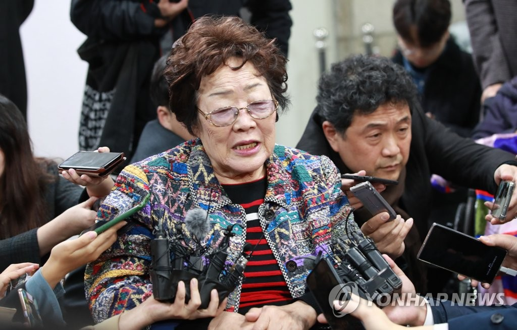 Lee Yong-soo speaks to reporters after she testified at the first court hearing on a compensation suit filed by Korean victims of Japan's wartime sex slavery at the Seoul Central District Court in southern Seoul on Nov. 13, 2019.