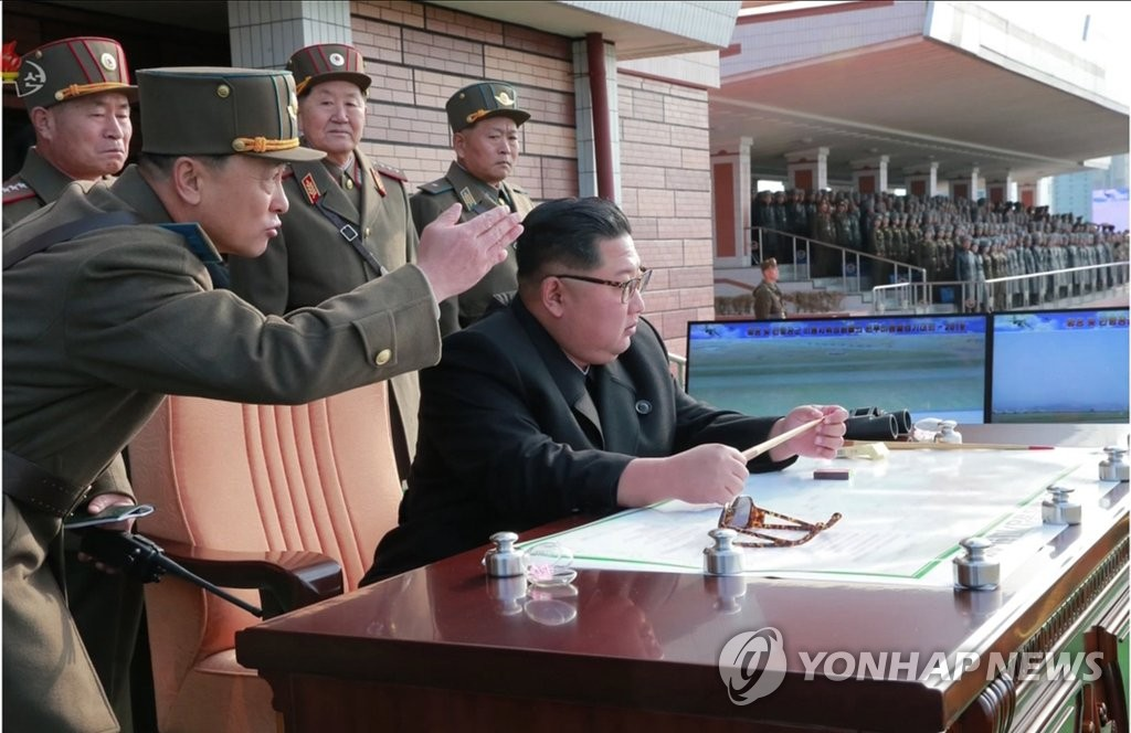 This photo, released by the North's Korean Central News Agency, shows North Korean leader Kim Jong-un (sitting) attending the combat flight contest held at Wonsan-Kalma airfield on Nov. 16, 2019. (For Use Only in the Republic of Korea. No Redistribution) (Yonhap)