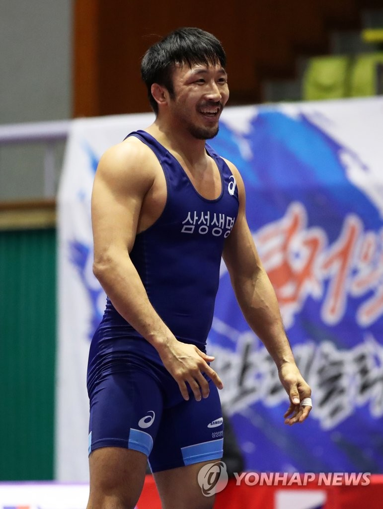 In this file photo from Jan. 14, 2020, South Korean Greco-Roman wrestler Ryu Han-su smiles during a match at the Olympic trials at Hampyeong Culture and Sports Center in Hampyeong, 380 kilometers south of Seoul. (Yonhap)