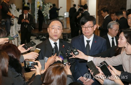 Finance minister and presidential aide meet reporters