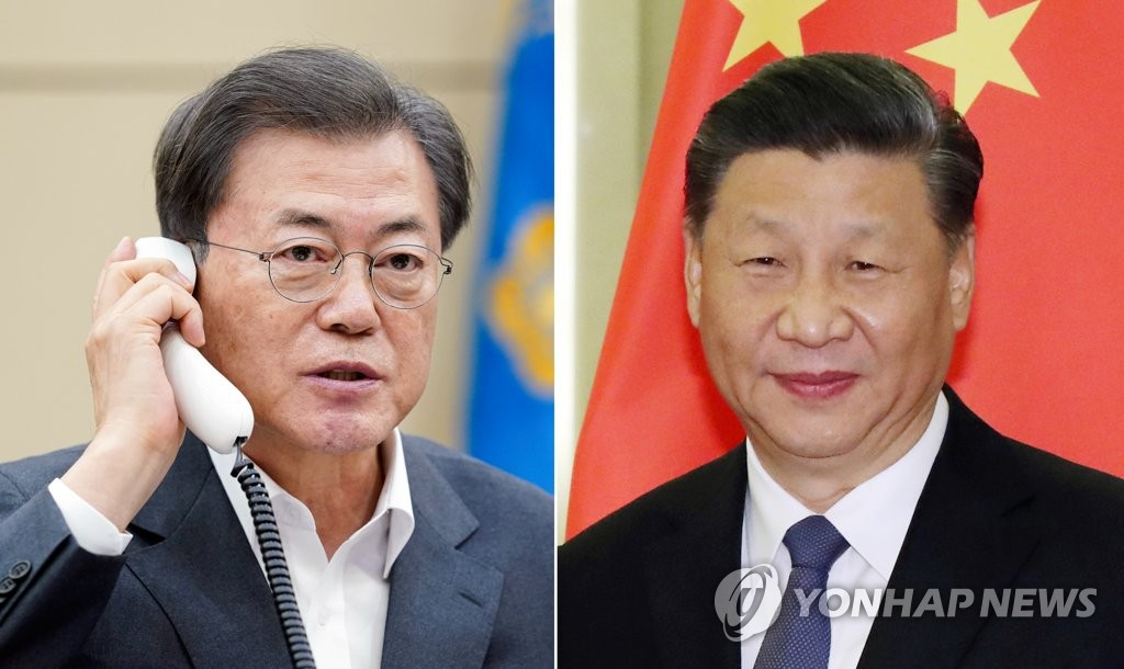 South Korean President Moon Jae-in (L) and Chinese President Xi Jinping in a combined file photo provided by Cheong Wa Dae. (PHOTO NOT FOR SALE)
