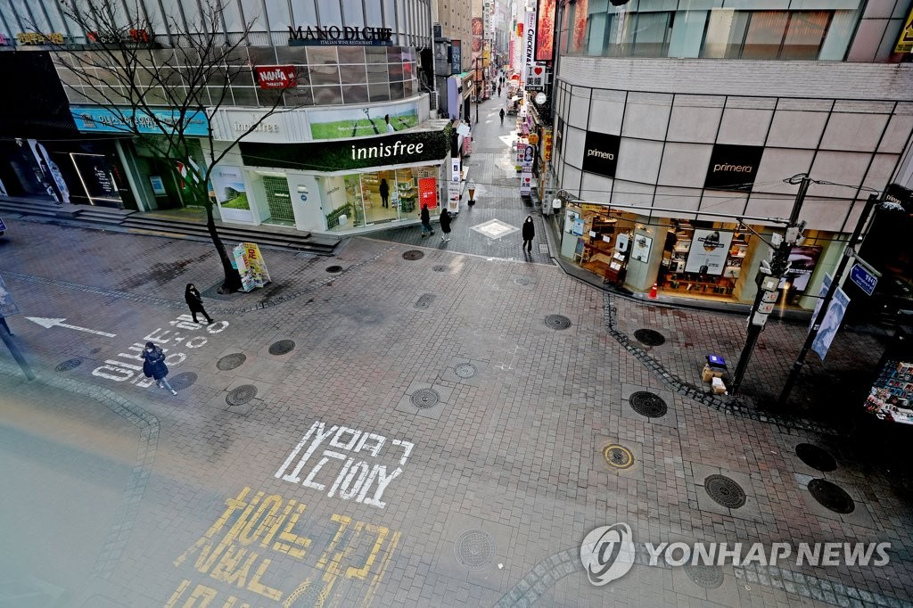 The file photo, taken Feb. 29, 2020, shows nearly empty streets in Myeongdong, one of the most popular shopping districts in Seoul, amid a sharp increase in online sales caused by the outbreak of the new coronavirus. (Yonhap)