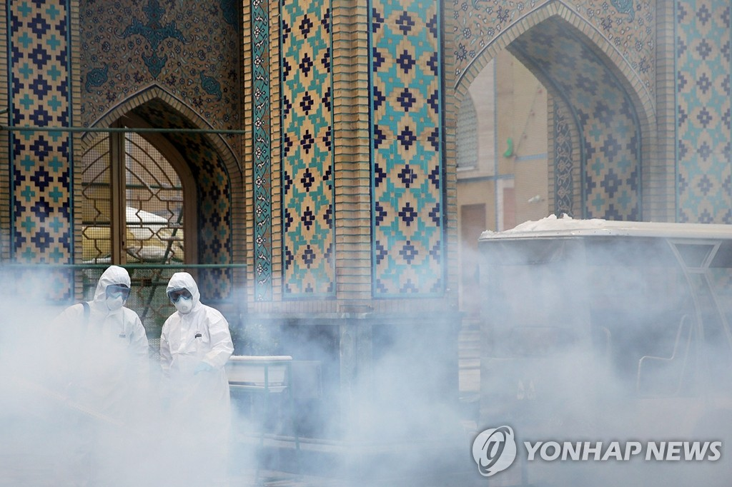 This Reuters photo shows quarantine work being carried out at the Imam Reza shrine in Mashhad, the second most populous city in Iran, on Feb. 27, 2020 (Iran time). (Yonhap)