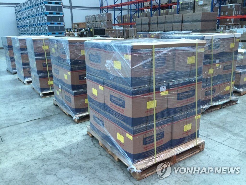 This photo, provided by the foreign ministry on March 17, 2020, shows boxes containing coronavirus specimen collection kits piled at a warehouse near Incheon International Airport, west of Seoul, before being shipped to the United Arab Emirates. South Korea said it has recently exported 51,000 kits to the Middle Eastern country. (PHOTO NOT FOR SALE) (Yonhap)