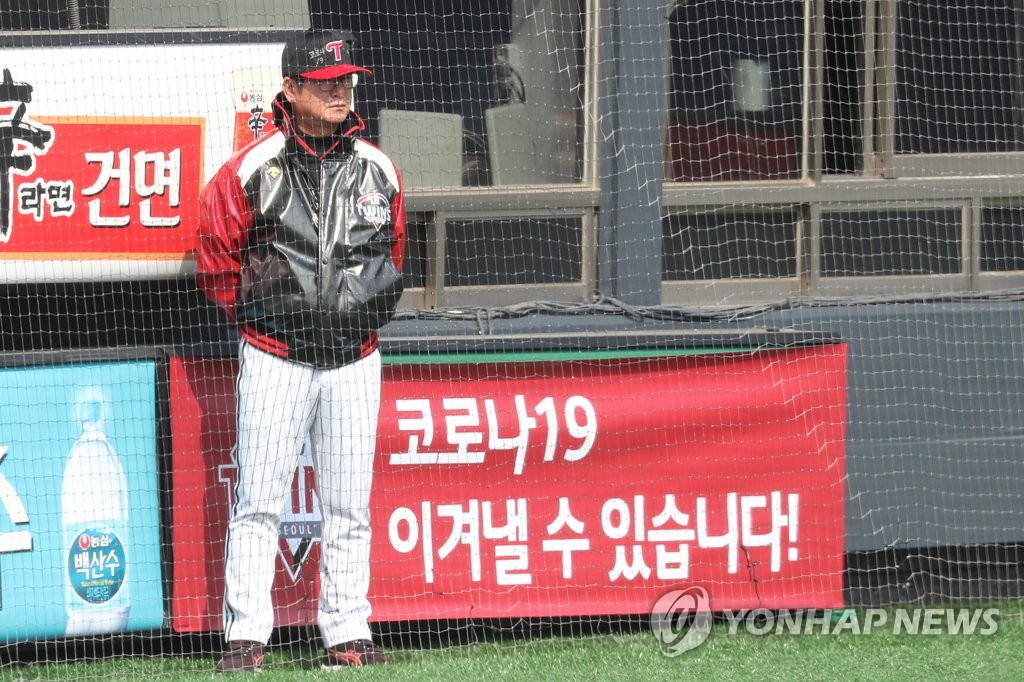 In this file photo from April 2, 2020, Ryu Joong-il, manager of the LG Twins, watches his team's intrasquad game at Jamsil Stadium in Seoul. (Yonhap)