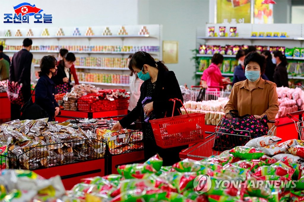 North Korean customers wearing masks shop at the Pyongyang Department Store amid the coronavirus pandemic, in this undated photo taken from North Korea's propaganda website DPRK Today on May 29, 2020. (PHOTO NOT FOR SALE) (Yonhap)