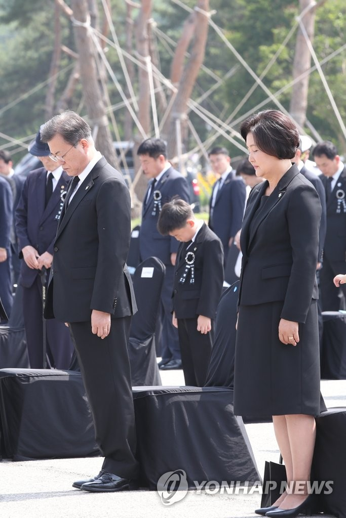 President Moon Jae-in and first lady Kim Jung-sook keep their heads low in a silent tribute during the 65th Memorial Day ceremony at Daejeon National Cemetery in the city located 160 kilometers south of Seoul on June 6, 2020.