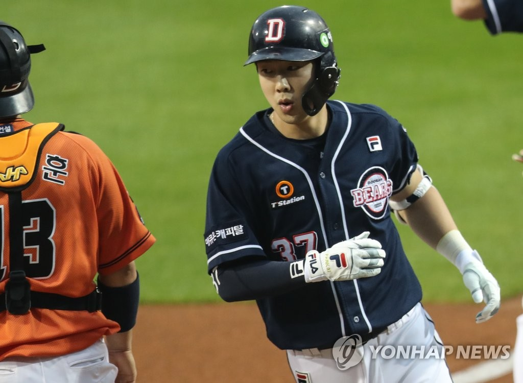 In this file photo from June 12, 2020, Park Kun-woo of the Doosan Bears touches home plate after hitting a solo home run against the Hanwha Eagles in a Korea Baseball Organization regular season game at Hanwha Life Eagles Park in Daejeon, 160 kilometers south of Seoul. (Yonhap)