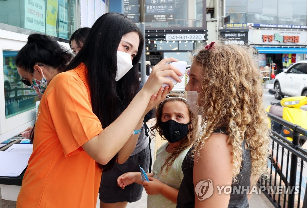 Foreigners get temperatures checked