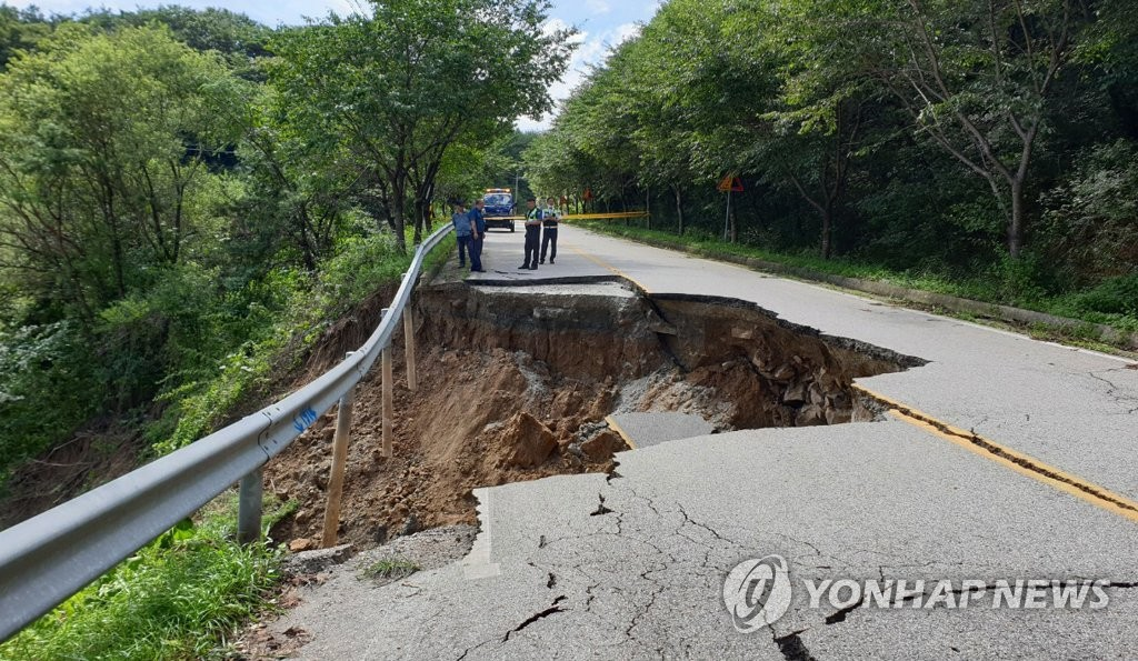This photo, provided by the office of North Jeolla Province on Aug. 9, 2020, shows a road in Jangsu, North Jeolla Province, that was damaged due to the recent heavy downpours. (PHOTO NOT FOR SALE)