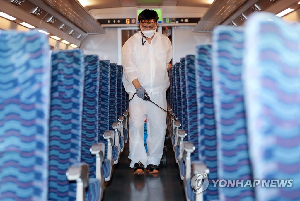 A worker disinfects seats of a train car at Suseo Station in southern Seoul on Sept. 21, 2020. (Yonhap)
