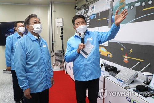 Moon visits automotive supplier