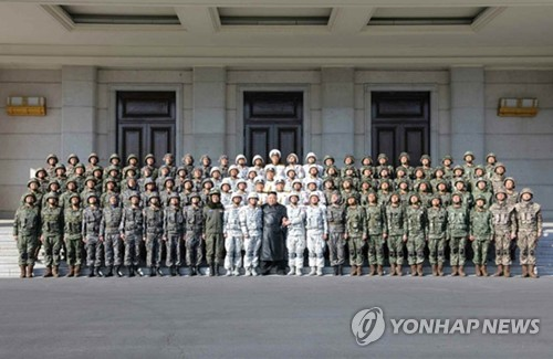 North Korean leader and his soldiers