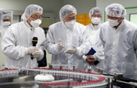 (LEAD) Moon visits coronavirus vaccine plant, announces potential deal with Novavax for 20 mln