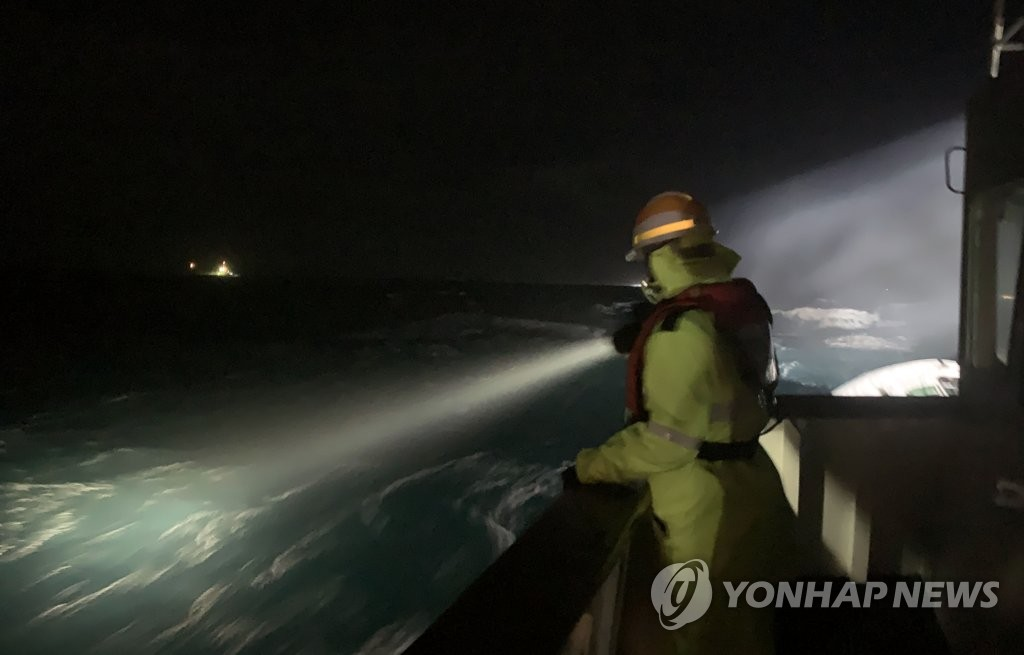 A search operation is under way in waters off the southern island of Geoje after a fishing boat capsized on Jan. 23, 2021, in this photo provided by the Coast Guard. (PHOTO NOT FOR SALE) (Yonhap)