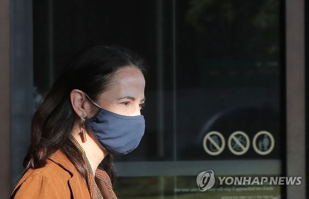 U.S. Director of National Intelligence Avril Haines walks out of a hotel in Seoul on May 13, 2021. (Yonhap)