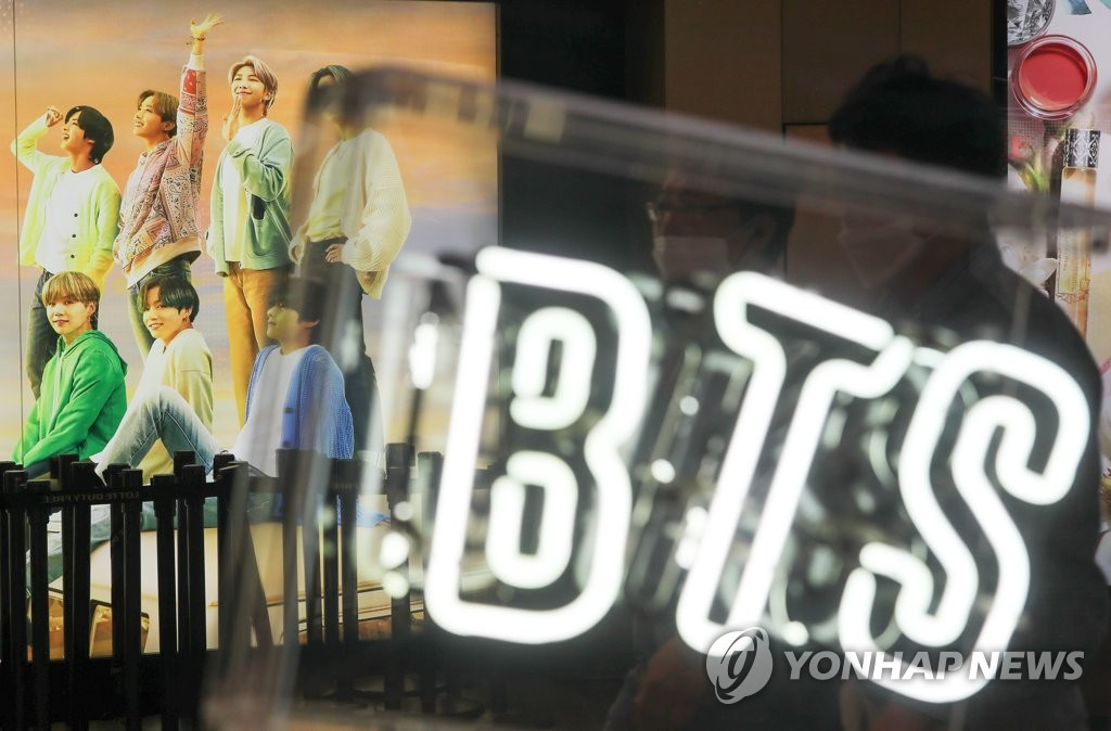 This file photo, taken June 29, 2021, shows an ad poster of BTS at a Lotte Duty Free store in central Seoul. (Yonhap)