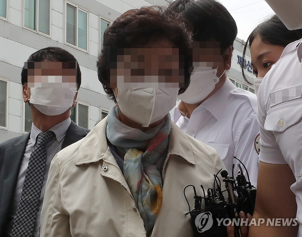 The mother-in-law of former Prosecutor General Yoon Seok-youl arrives for her sentencing hearing at the Uijeongbu District Court in the city 23 kilometers north of Seoul on July 2, 2021. (Yonhap)