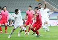 Hong Chul of South Korea (R) and Sherko Karim of Iraq battle for the ball during the teams' Group A match in the final Asian qualifying round for the 2022 FIFA World Cup at Seoul World Cup Stadium in Seoul on Sept. 2, 2021. (Yonhap)